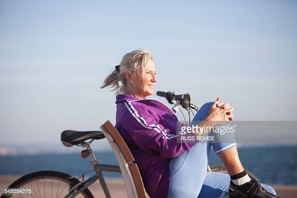 senior woman enjoying ocean view on bench - old women in pantyhose stock pictures, royalty-free photos & images