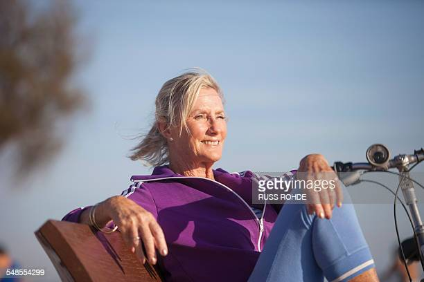 senior woman enjoying ocean view on bench - old women in pantyhose stock photos and pictures