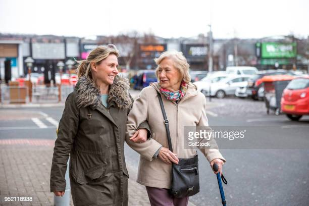 senior woman enjoying shopping - carers stock photos and pictures
