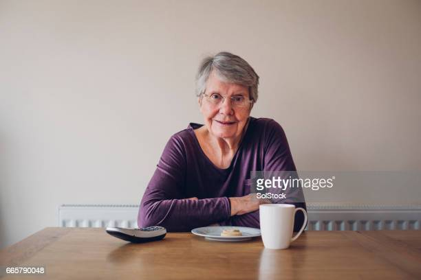 Senior Woman Enjoying Tea & Bisciut