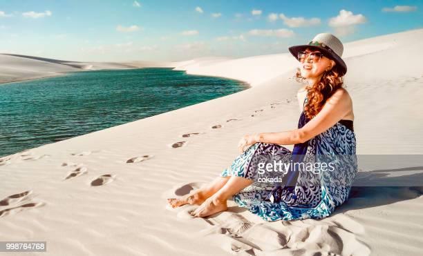 senior woman enjoying the view of lençois maranhenses - barreirinhas stock pictures, royalty-free photos & images