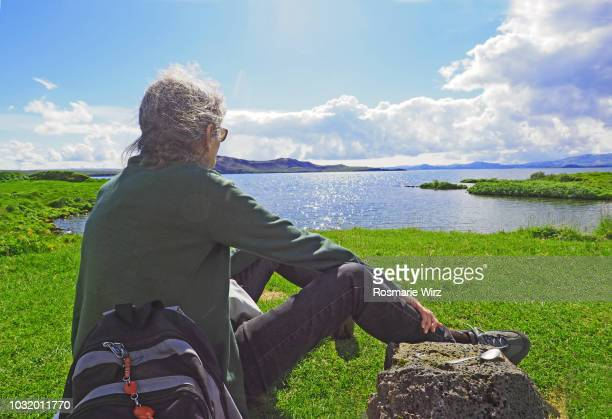 Senior woman enjoying view near lake Thingvallavatn, Iceland