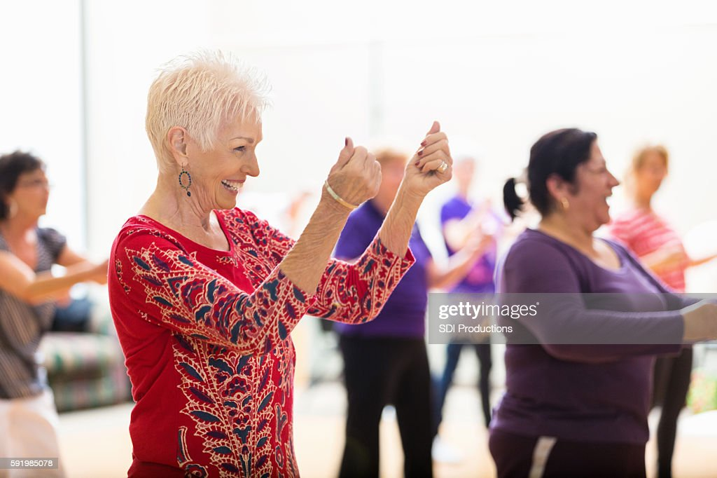 Senior woman enjoys dance class : Stock Photo