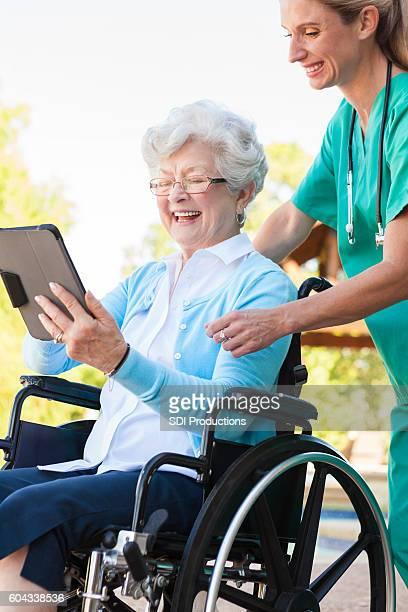 Senior woman enjoys using digital tablet