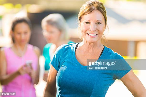 Senior woman exercises in the park