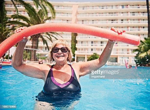 Senior woman exercising in pool