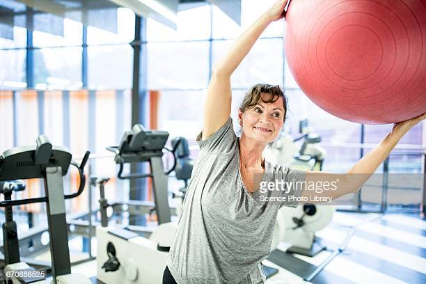 Senior woman exercising with fitness ball
