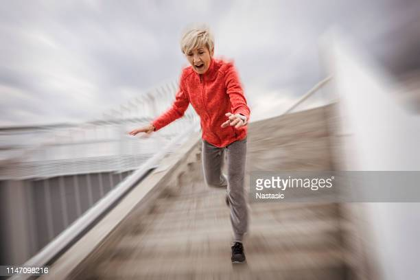senior woman falling down stone steps outdoors - autumn falls stock pictures, royalty-free photos & images