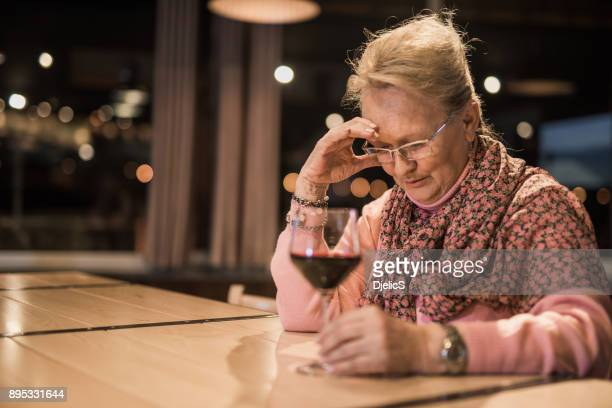 senior woman feeling depressed. - alcohol abuse stock pictures, royalty-free photos & images