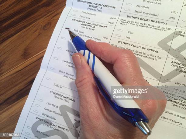 Senior woman filling out a St John's County State of Florida sample ballot for the midterm election November 4 2014