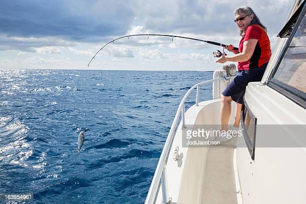Senior woman fishing