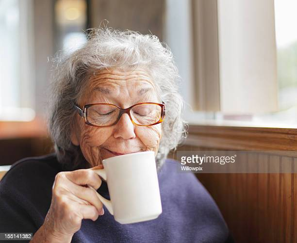 senior woman funny face smile with coffee cup - senior women stock pictures, royalty-free photos & images