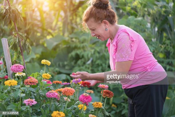 senior woman gardening in backyard
