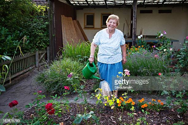 senior woman gardening - fat old women stock pictures, royalty-free photos & images