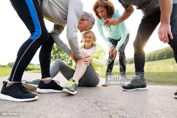 Senior woman gets injured throughout running.