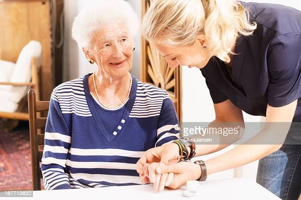 senior woman getting care an assistance - massage parlour stock photos and pictures