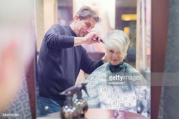 senior woman getting new hair cut - haare schneiden stock-fotos und bilder