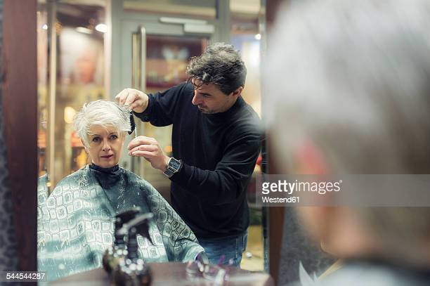 Senior woman getting new hair cut