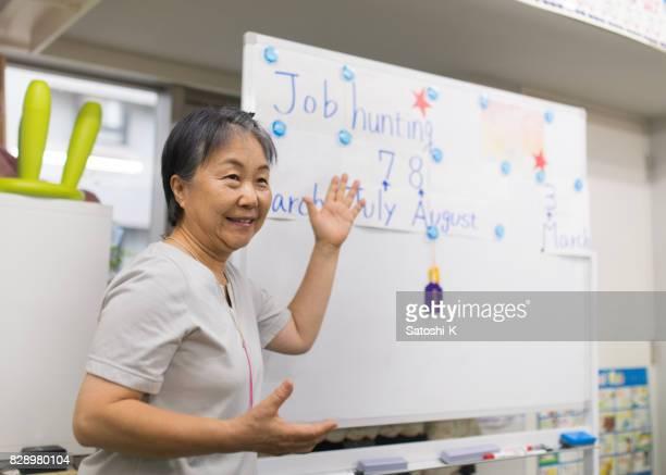 Senior woman giving presentation of job hunting