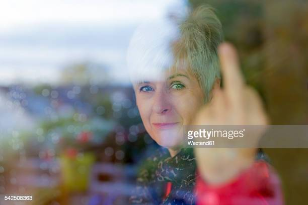 Senior woman giving the finger