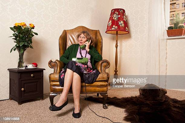 a senior woman gossiping on the phone - gossip stock pictures, royalty-free photos & images