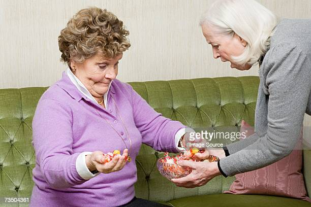 Senior woman grabbing sweets