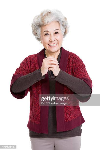 Senior woman greeting for Chinese New Year