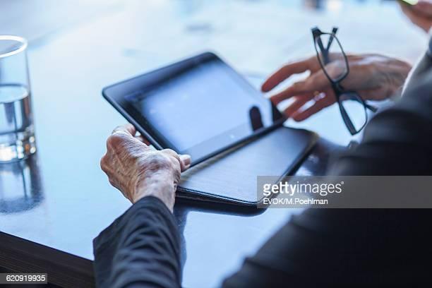 Senior woman hands detail holding computer tablet