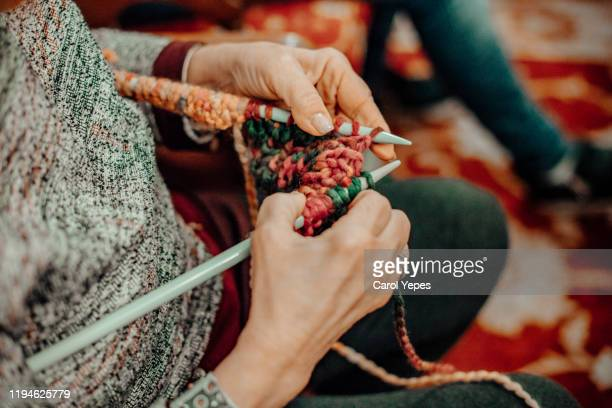 senior woman hands knitting a xmas sweater - jumper stock pictures, royalty-free photos & images