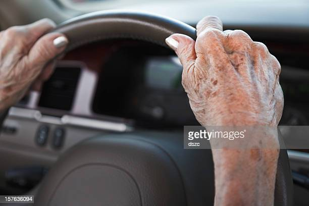 senior woman hands on steering wheel - lentigo stock pictures, royalty-free photos & images