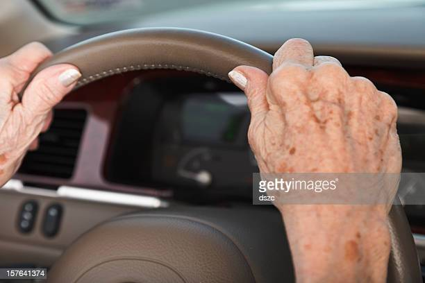 senior woman hands on steering wheel - liver spot stock photos and pictures