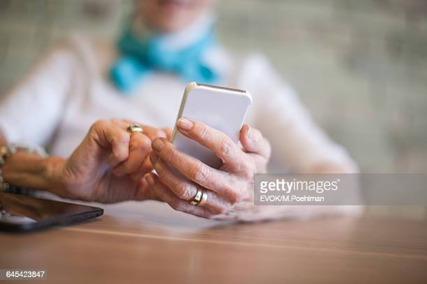 Senior woman hands texting