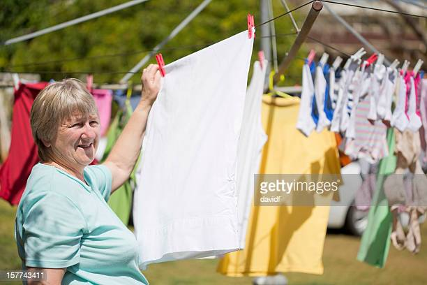 Senior Woman Hanging Clothes on the Washing Line