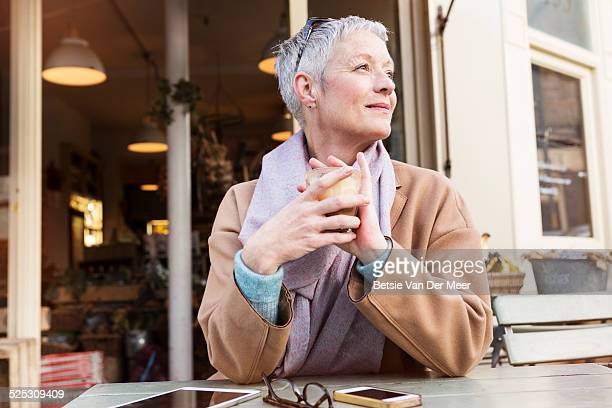 senior woman having a coffee outside in cafe. - 短毛 個照片及圖片檔