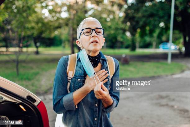 senior woman having breathing difficulties - problems stock pictures, royalty-free photos & images