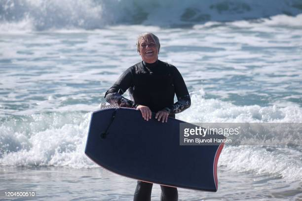 senior woman having fun with bodyboarding on the beach - finn bjurvoll - fotografias e filmes do acervo