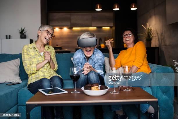 Senior woman having fun with virtual reality headset