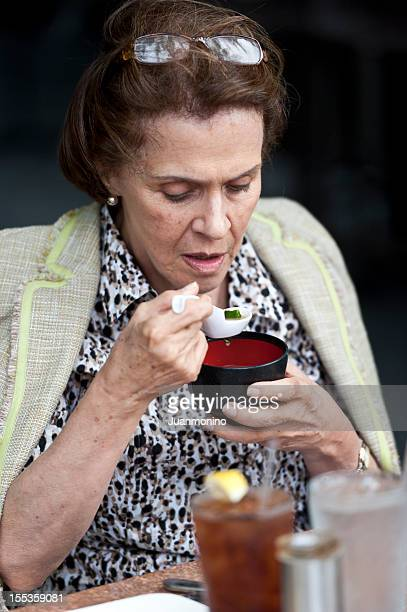 Senior woman having japanese soup