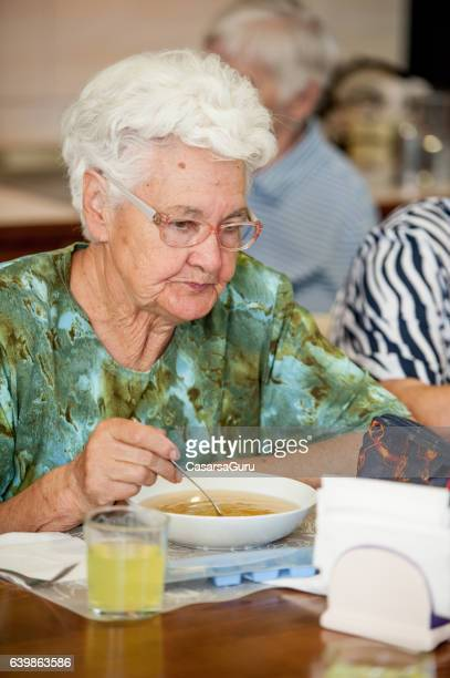Senior Woman Having Lunch in the Retirement Home