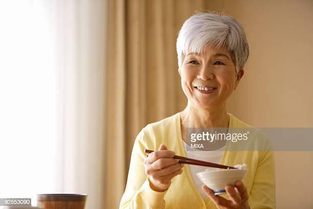 Senior woman having meal