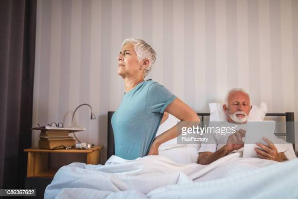 senior woman having problems with her back - herniated disc stock pictures, royalty-free photos & images