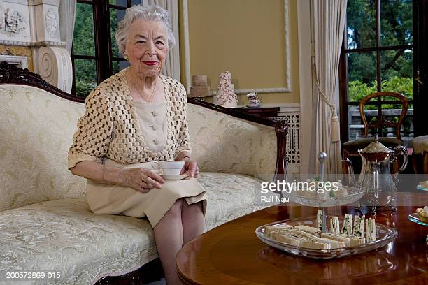 senior woman having tea, smiling, portrait - afternoon tea stock pictures, royalty-free photos & images