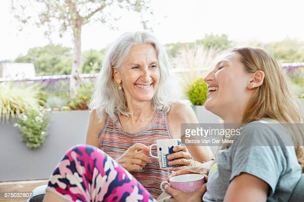 Senior woman having tea with daughter at home