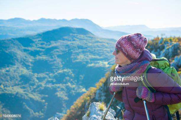 senior woman hiking at autumnal dawn in southern julian alps, europe - images stock pictures, royalty-free photos & images