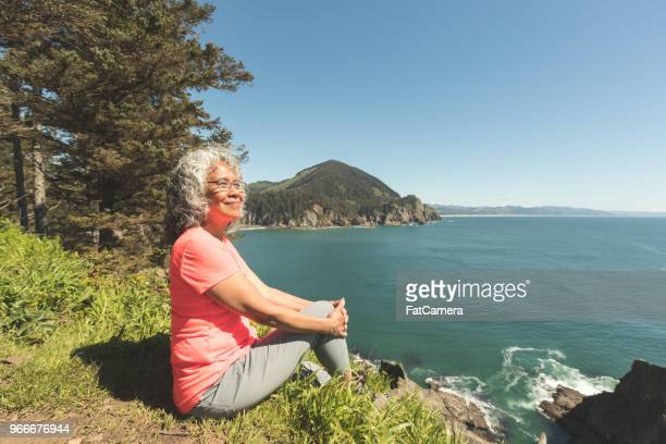 senior woman hiking on the oregon coast - pacific ocean stock pictures, royalty-free photos & images