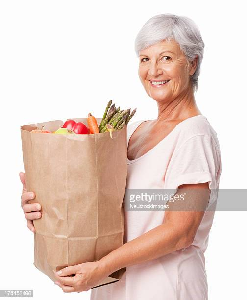Senior Woman Holding a Bag Of Fresh Groceries - Isolated