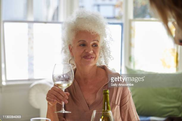 Senior woman holding a glass of wine