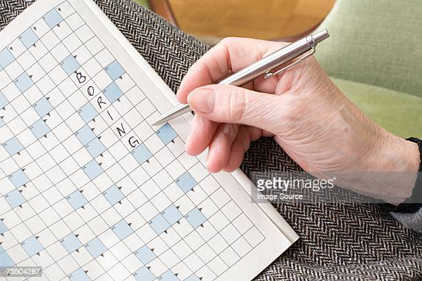 Senior woman holding a word game