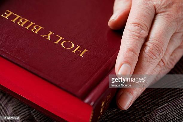 Senior woman holding bible