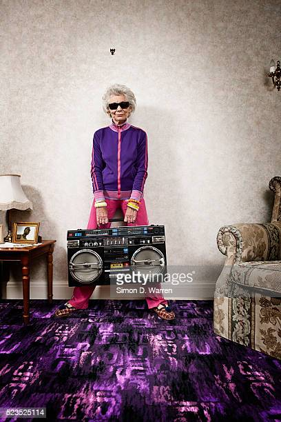 senior woman holding boom box - old lady funny stock pictures, royalty-free photos & images